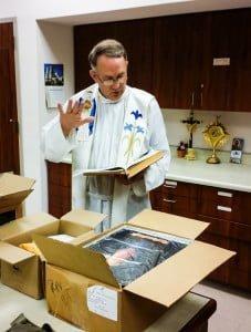 Fr. Jim Kelleher SOLT blesses images of Jesus, The Divine Mercy at Our Lady of Corpus Christi Shrine in Corpus Christi, TX.